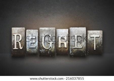 The word REGRET written in vintage letterpress type - stock photo