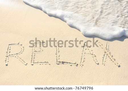 The Word Relax Written in the Sand on a Beach - stock photo