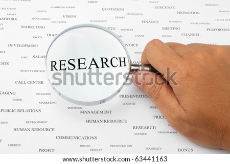 The word RESEARCH is magnified. - stock photo
