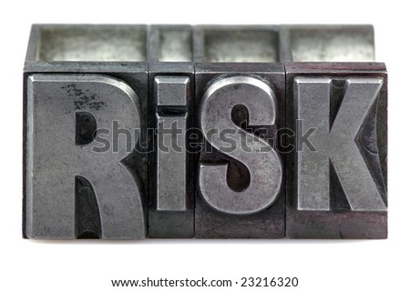 The word Risk in old letterpress printing blocks isolated on a white background. - stock photo