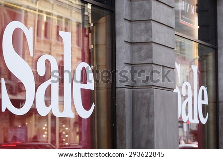 "The word ""Sale"" on a show window"