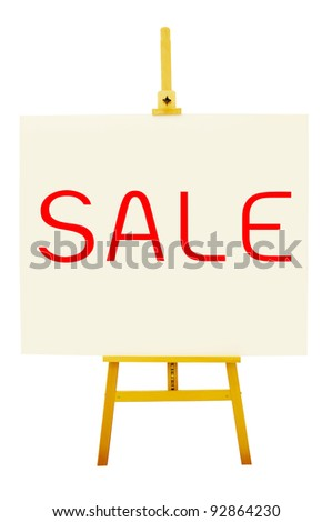 the word Sale on art board with easel - stock photo