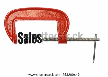 "The word ""Sales"" is compressed with a vice. Business metaphor. - stock photo"
