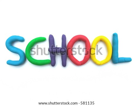 The word SCHOOL in dough or clay letters - stock photo