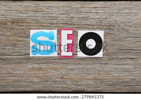 The word search engine optimization in cut out magazine letters  - stock photo