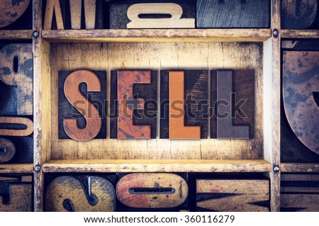 "The word ""Sell"" written in vintage wooden letterpress type."