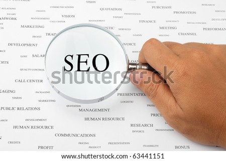 The word SEO is magnified. - stock photo