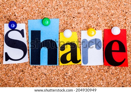 The word Share in cut out magazine letters pinned to a cork notice board - stock photo