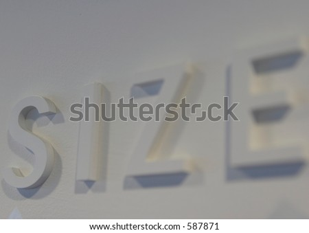"The word ""size"" embossed on a white wall, partially blurred"