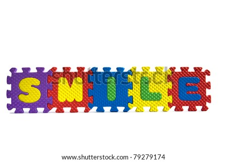 """The word """"Smile"""" written with alphabet puzzle letters isolated on white background - stock photo"""