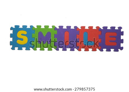 """The word """"SMILE"""" written with alphabet puzzle letters isolated on white background. Alphabet puzzle pieces on white background - stock photo"""