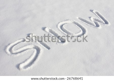 "The word ""SNOW"" imprinted in a fresh snowy field under bright sunlight - stock photo"
