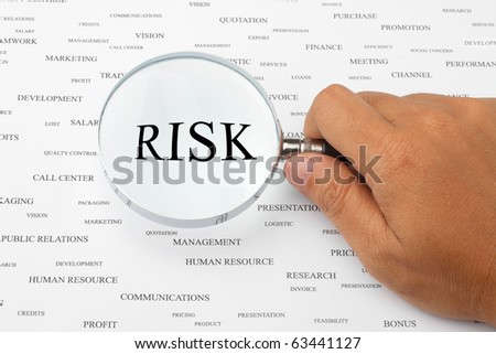 The word SOCIAL RISK is magnified. - stock photo