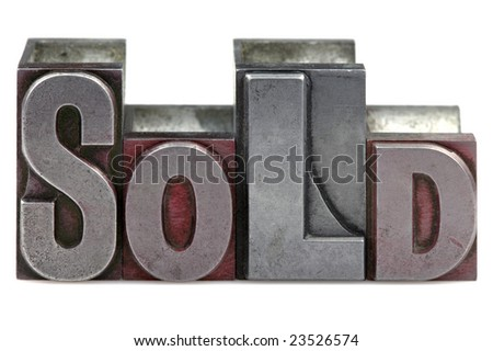 The word Sold in old letterpress printing blocks isolated on a white background. - stock photo