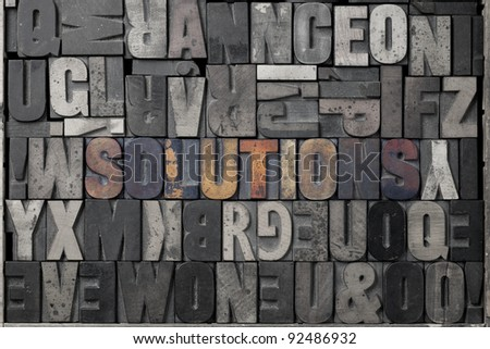 The word solutions written out in old letterpress blocks. - stock photo