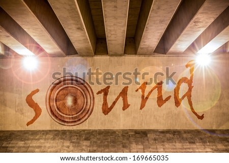 The word sound with bass speaker as graffiti on the support column of an overpass - stock photo