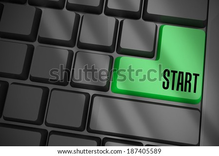 The word start on black keyboard with green key