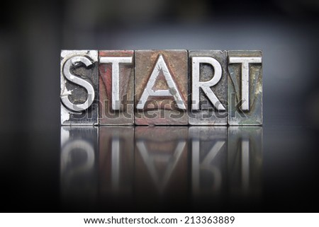 The word Start written in vintage letterpress type - stock photo