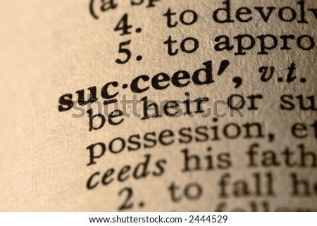 The word succeed. Close-up of the word succeed in a dictionary. - stock photo