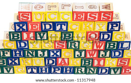 The word success at the top of a wall of baby building blocks