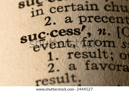 The word success. Close-up of the word success in a dictionary. - stock photo
