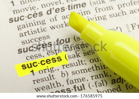 The Word Success Highlighted in Dictionary with Yellow Marker Highlighter Pen. - stock photo
