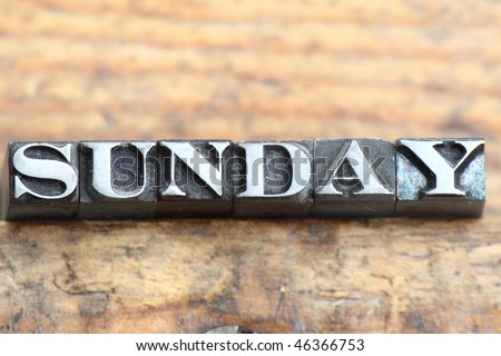 the word sunday in letterpress type on a wooden background. - stock photo
