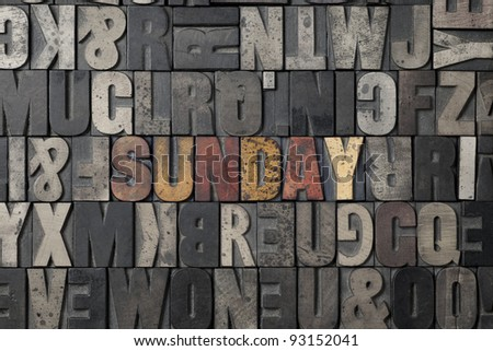 The word Sunday written out in old letterpress blocks. - stock photo