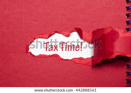 The word tax time appearing behind torn paper - stock photo