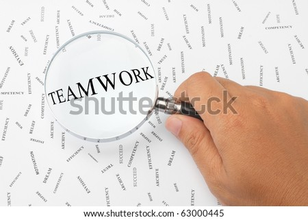 The word, TEAMWORK is magnified. - stock photo