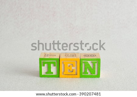 The word ten (10) spelled with colorful alphabet blocks isolated against a white background - stock photo