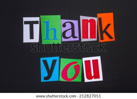 The word thank you in cut out magazine letters on blackboard - stock photo