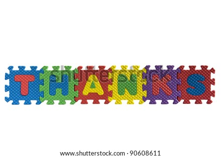 "The word ""Thanks"" written with alphabet puzzle letters isolated on white background"