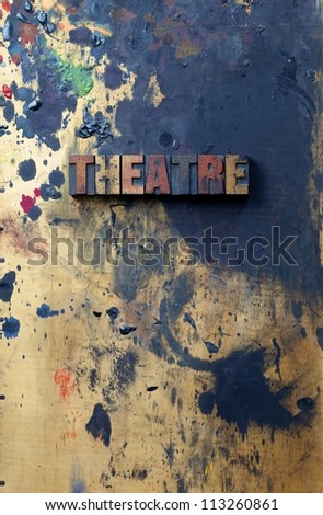 The word Theater written in antique letterpress printing blocks. - stock photo