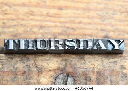 the word thursday in letterpress type on a wooden background. - stock photo