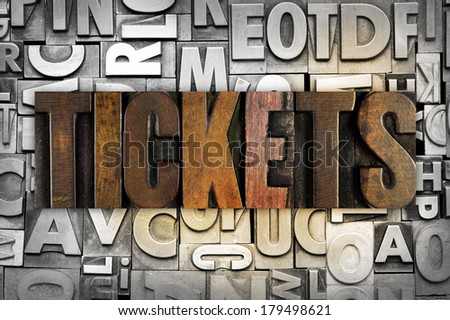 The word TICKETS written in vintage letterpress type