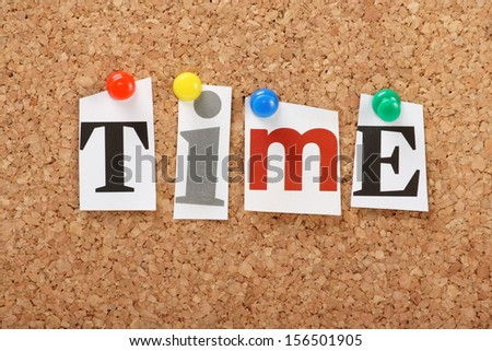 The word Time in cut out magazine letters pinned to a cork notice board - stock photo