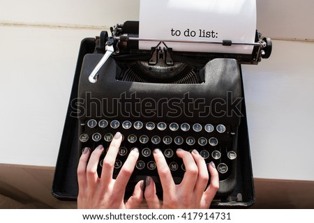The word to do list: against womans hand typing on typewriter - stock photo