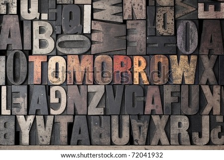 The word 'Tomorrow' spelled out in very old letterpress blocks. - stock photo