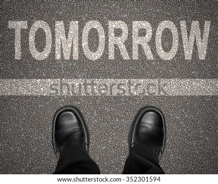 Word tomorrow stripe on road business stock photo 352301594 the word tomorrow with stripe on road and business man shoes standing still top view publicscrutiny Images