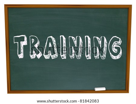 The word Training written or drawn on a school classroom chalk board, illustrating the need and importance to be educated in skills that will help you succeed in life - stock photo