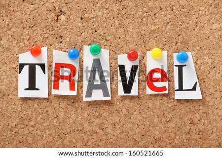 The word Travel in cut out magazine letters pinned to a cork notice board. We check the news for Travel and transport issues and read the travel sections of the newspapers for holiday inspiration. - stock photo