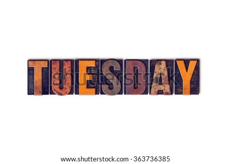 """The word """"Tuesday"""" written in isolated vintage wooden letterpress type on a white background. - stock photo"""