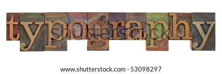 the word typography in old wooden letterpress type stained by color ink, isolated on white - stock photo