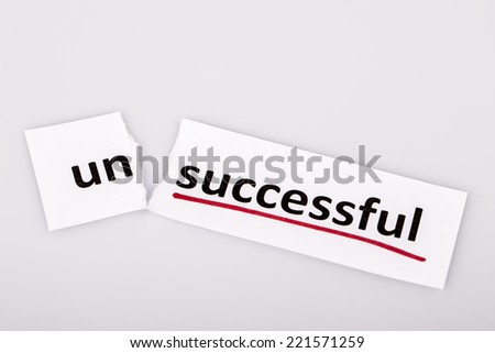 The word unsuccessful changed to successful on torn paper and white background