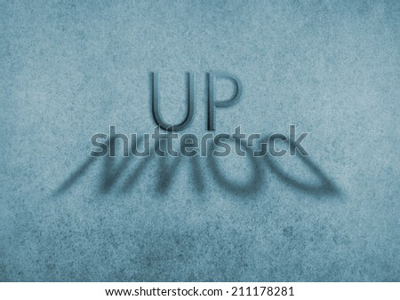 the word up with a shadow of the word down - stock photo
