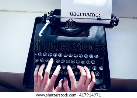 The word username: against womans hand typing on typewriter - stock photo