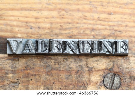 the word valentine in letterpress type on a wooden background. - stock photo