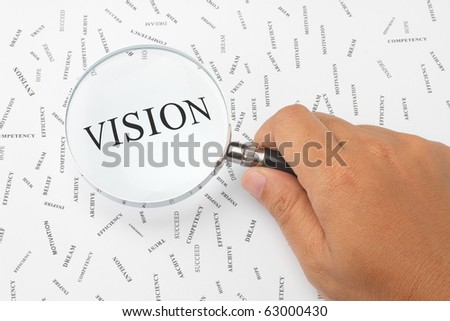 The word, VISION is magnified. - stock photo