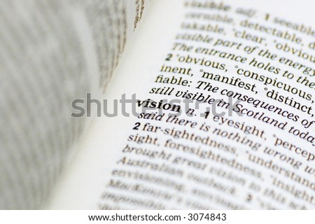 The word vision written in a thesaurus - stock photo